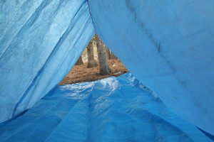 Place a smaller tarp or poncho inside the A-Frame, with the edges raised. This will provide a dry sleeping area, and will keep water from draining downhill onto your gear.