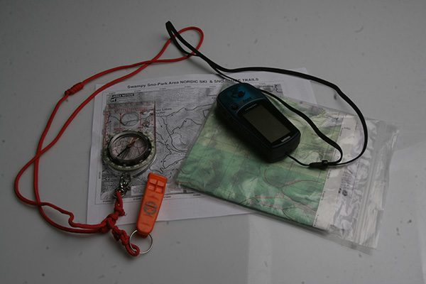 A map, compass, GPS should be part of any survival kit, and may be of value once you get out of the collapsing building. The whistle may be one of the tools that helps you get out!