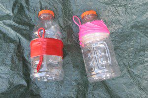 It took some duct tape and parachute cord to make these quart Gatorade containers in serviceable canteens.