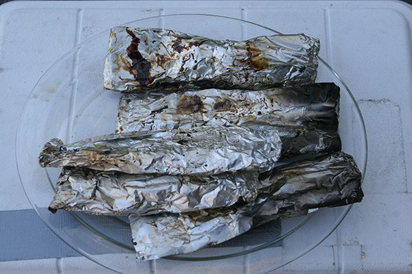 Small fish are easily cooked in a wrapping of aluminum foil over a grill or campfire.