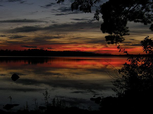 Sunset over a lake in the Boundary Waters.