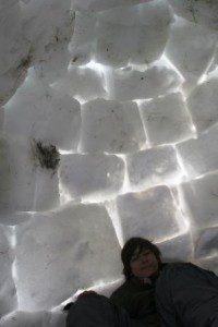 Igloo interior during winter camping outing.