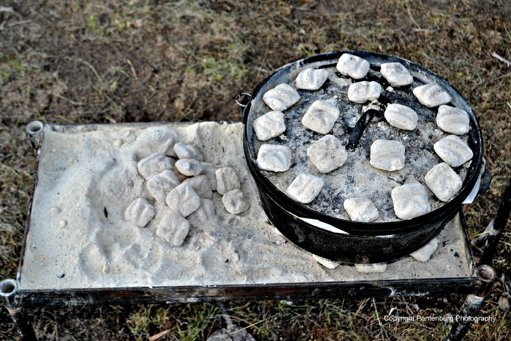Twelve inch camp oven cooing with charcoal.