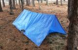 Knowing how to make a simple A-frame tarp shelter is a basic survival skill.