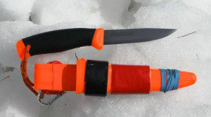This Mora Clipper sheath has been modified so it will swing freely on a belt, secure the knife and provide a convenient place to carry duct tape! (Pantenburg Photo)