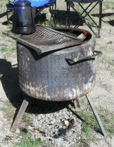 This dryer basket was improved with legs, handles and a grill. Total cost of the unit is still dirt cheap!