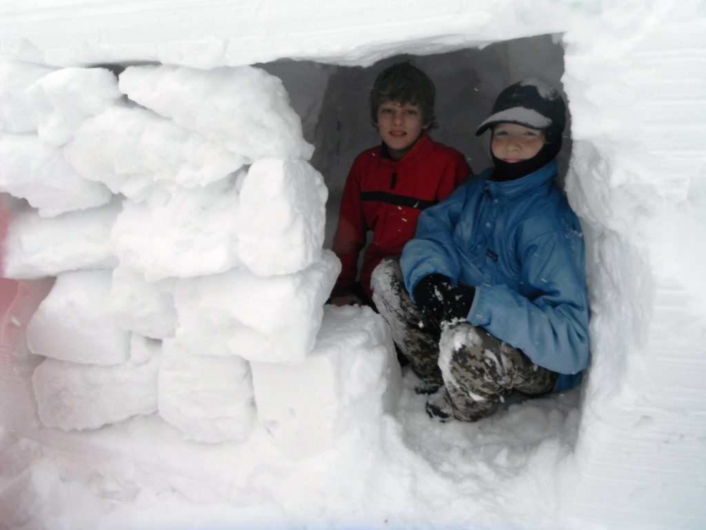 If these Boy Scouts were going to spend the night in this snow cave, they'd need a good sleeping bag and pad. (Pantenburg photo)