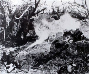 A Marine from 1st Marine Division uses a flamethrower to clear a path through what was once a thick jungle in Tarawa - 1943 (National Archives, Marine Corps)