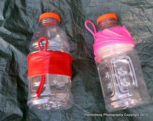 These quart electrolyte drink plastic bottles can make servicable canteens when some paracord and duct tape are used. They are easily carried on a belt clip.