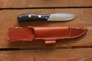 The Canadian comes with a leather KSF sheath.