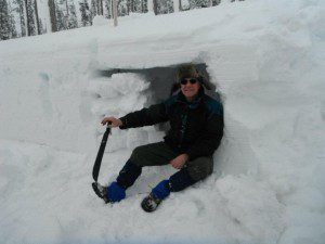 Building an effective snow cave takes hard work and the right tools.
