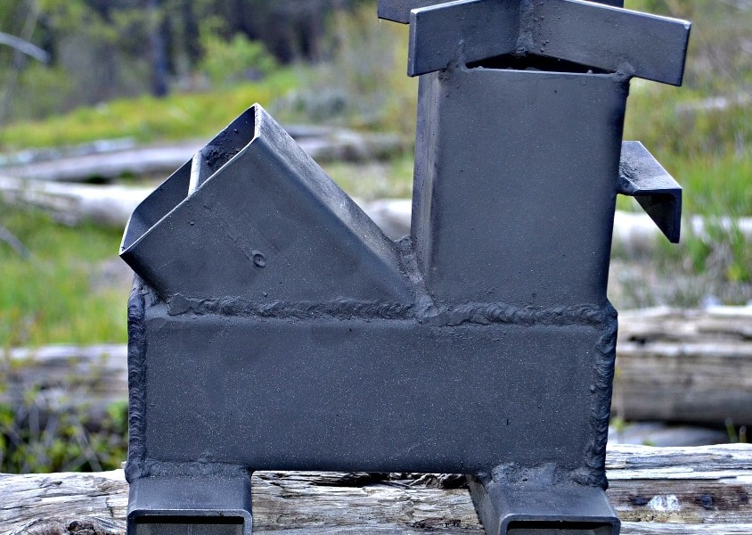 Review is the wood mite gravity feed rocket stove the for Rocket wood stove design