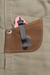 The reenforced leather tab in the right front pocket is designed for tape measures, but works well for knives.