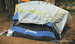 A tarp or piece of plastic can improve a tent's efficiency and keep the rain out.