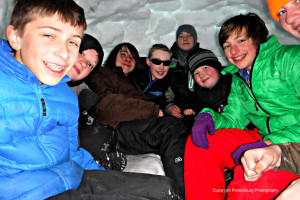 These Boy Scouts crowded into an igloo during a winter campout. They have bragging rights.
