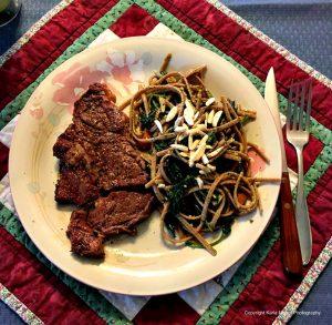 Dinner is served: T-bone steaks, nettles and pasta.