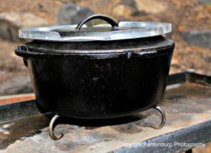 A pie crust saver and trivet can convert an indoor oven into an outdoor baker.