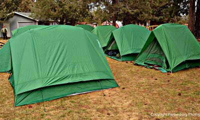 Set up a new tent in your backyard before taking it camping.