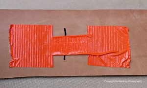 This demo bandage shows how to improvise a butterfly bandage with duct tape.