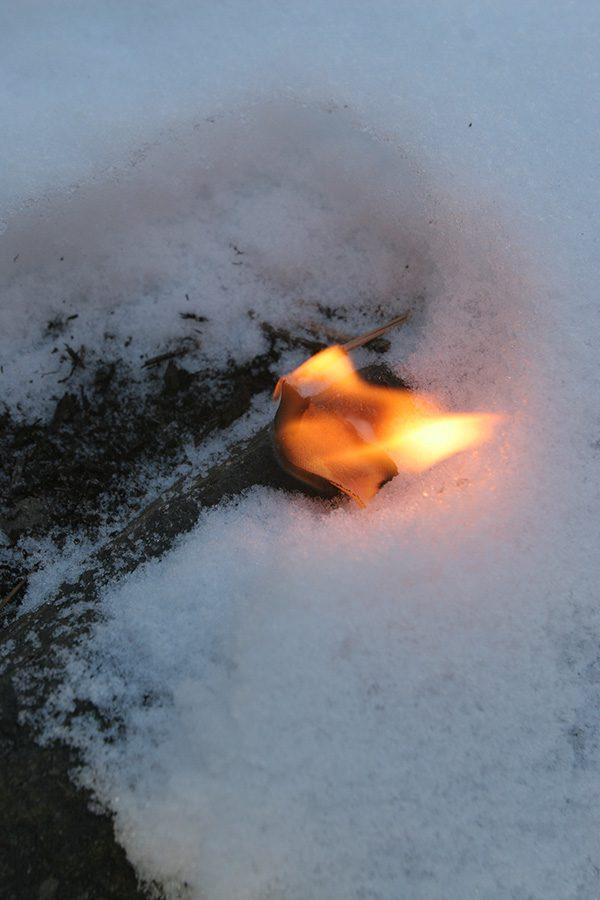 SurvivalCommonSense firestarter burning on snow