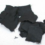"""The denim material is """"cooked"""" in an airtight container until it is black. Then it will catch a spark."""