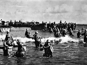 Marines wade ashore on Tinian (National Archives, Marine Corps)