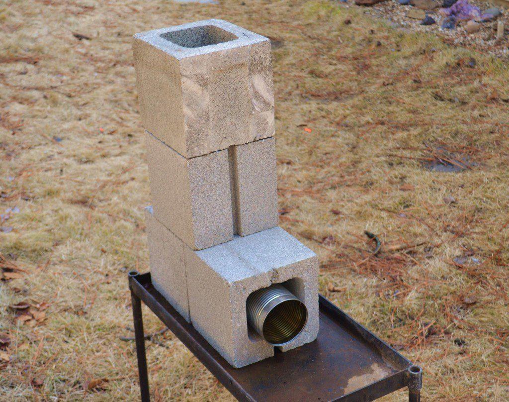 Build a concrete block rocket stove survival common for 4 block rocket stove