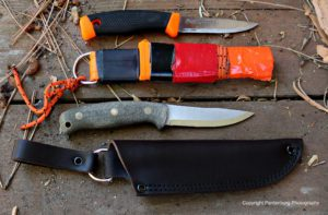 The Mora sheath, top needs to be modified for safe carry. The Feather Stick comes with a leather dangler.